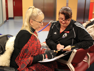 CAC member Sharon King Harris talks with a patient