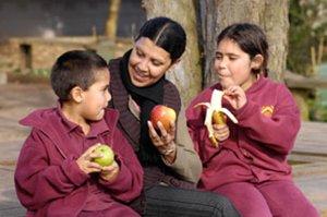 School children eating fruit